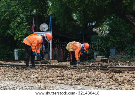Bangkok, Thailand - September 5, 2015 : Unidentified railway employees working for restoration the railroad tracks before serving at State Railway of Thailand.