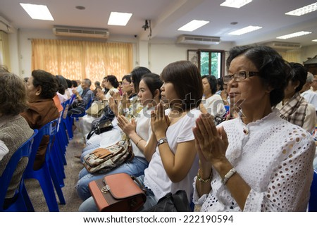 Bangkok , Thailand - September 21, 2014:  Unidentified Thai Buddhist people sit around indoor  for listen to Dhamma of Buddhism from monks at Wat Rajadhivas Temple in Dusit Area ,  Bangkok Thailand - stock photo