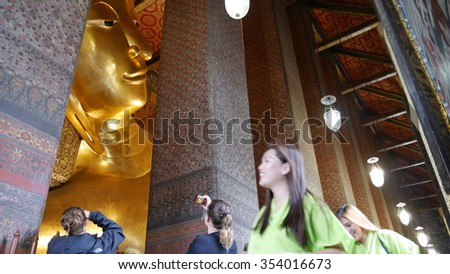 Bangkok, Thailand - September 11, 2015: View of Wat Pho or Temple of the Reclining Buddha. Tourists walk around  inside the temple. It is one of the most famous travel destinations in Thailand.