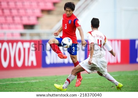 BANGKOK THAILAND-SEPTEMBER 17:Yun Seoho (RED) of  Korea Republic in actionduring the AFC U-16 Championship Korea Republic and Syria at Rajamangala Stadium on Sep17,2014,Thailand