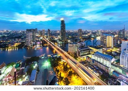 Bangkok Transportation at Dusk with Modern Business Building along the river (Thailand) - stock photo