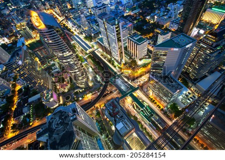 Bangkok Transportation at Dusk with Modern Business Building from top view (Thailand) - stock photo