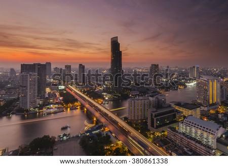 Bangkok view twilight color Chao Phraya River Sathorn Taksin bridge thailand - stock photo