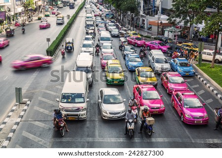 BANGOK, THAILAND - DECEMBER 16, 2015: big traffic in the city of Bangkok, with unidentified people. Bangkok is one of the most important economic and transport centres in South-East Asia - stock photo