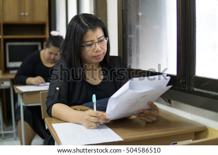 BANGPROK PATHUMTANI THAILAND OCTOBBER 2016 :Unidentified teachers are quiz on the exam sheet on October 25,2016 in Bangprok Muang Patumtani Thailand.