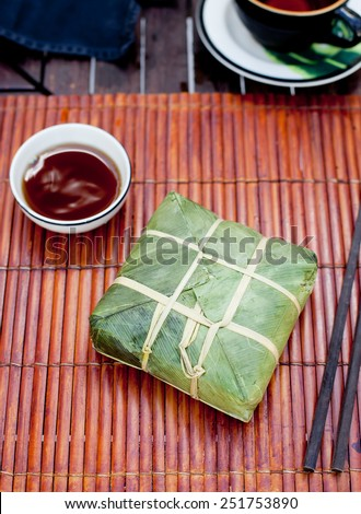 Banh chung, Traditional present for Lunar New Year, Vietnamese traditional dish. Sticky rice cake with meat , covered with banana leaves and, tied with bamboo rope