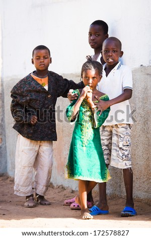 BANJUL, GAMBIA - MAR 14, 2013: Unidentified Gambian children play in the street in Gambia, Mar 14, 2013. Major ethnic group in Gambia is the Mandinka - 42%
