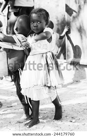 BANJUL, GAMBIA - MAR 14, 2013: Unidentified Gambian girl in a beautiful dress in Gambia, Mar 14, 2013. Major ethnic group in Gambia is the Mandinka - 42% - stock photo