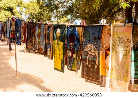 BANJUL, GAMBIA - MAR 14, 2013: Unidentified Gambian women wash the clothes in the street in Gambia, Mar 14, 2013. Major ethnic group in Gambia is the Mandinka - 42%