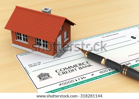 Bank Check with House and pen on the table