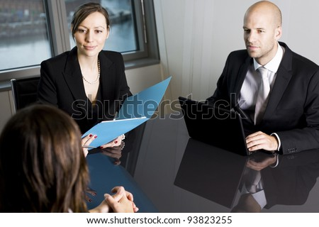 Bank consultants with client - stock photo