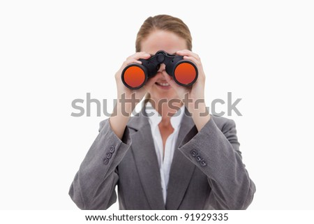 Bank employee using spy glasses against a white background - stock photo