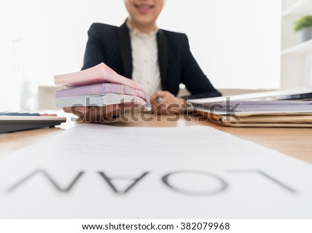 Bank employees paying money to debtor for the business loan or personal loan at bank office.  - stock photo