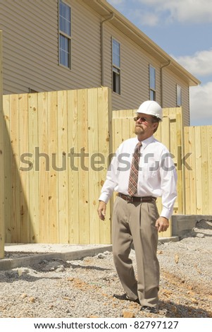 Bank finance personal inspecting new strip mall that his company financed