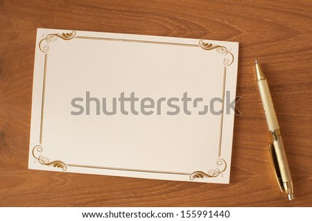 bank invitation card with pen - stock photo
