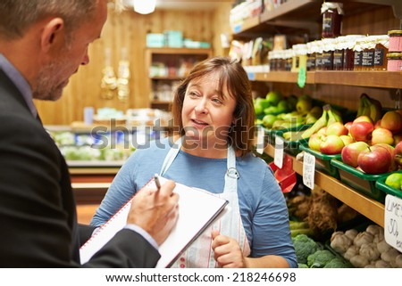 Bank Manager Meeting With Female Owner Of Farm Shop - stock photo