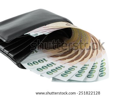 Bank note and black wallet over isolated background - stock photo