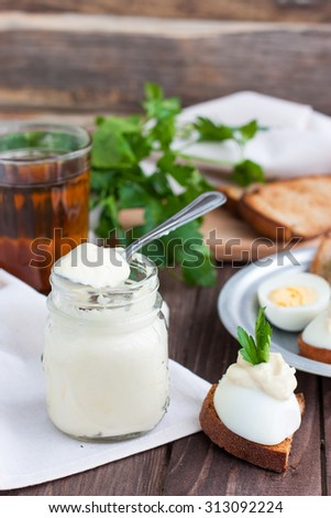 Bank of homemade mayonnaise with eggs and herbs - stock photo