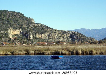 Bank of the river and rock graves near Dalyan, Turkey
