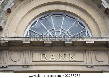 Bank Sign above Building Entrance - stock photo