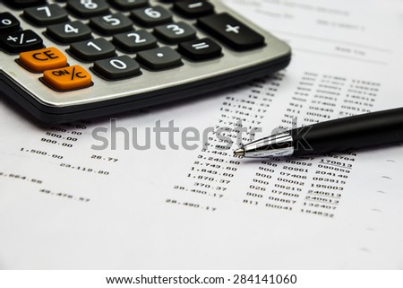 Bank statement and pen - stock photo