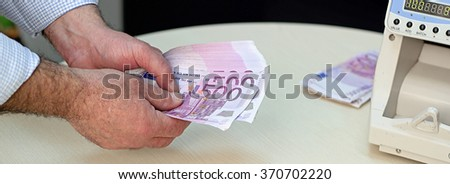 Banker Counting 500 Euro banknotes.  European Union Currency. Counting Money.  Business. Businessman counting 500 Euro banknotes.  - stock photo