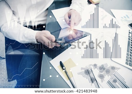 Banker manager working process.Photo analyst trader work market graphs.Using electronic device.Graphic icons,worldwide online stock exchanges interfaces on screen.Business project startup.Film effect. - stock photo