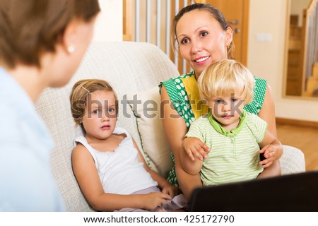 Banking assistant and mother arranging mortgage details - stock photo