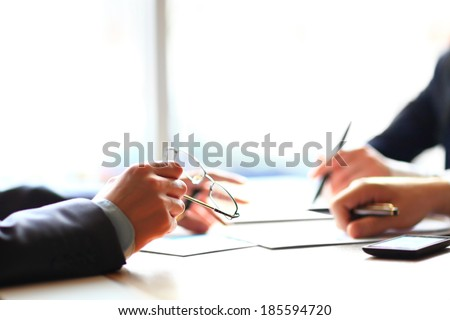 Banking business or financial analytics desktop with accounting charts, pen and glasses - stock photo