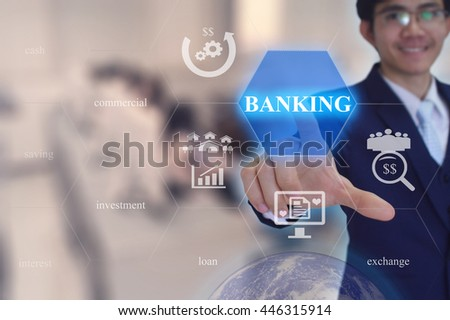 BANKING concept presented by  businessman touching on  virtual  screen -image element furnished by NASA- SOFT SILVER TONE - stock photo