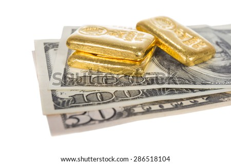banknote and gold bullion isolated on white - stock photo