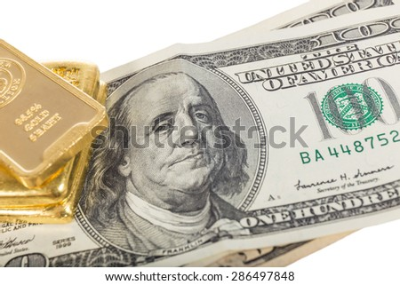 banknote and gold bullions isolated on white - stock photo