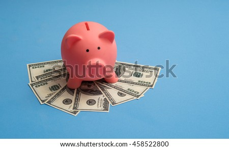 banknote and piggy coin saving, blue background, save money concept.