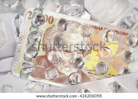 Banknote 20000 Armenian drams on an empty blister pack of tablets - stock photo