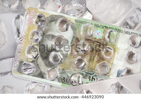 Banknote 5000 Armenian drams  on an empty blister pack of tablets - stock photo