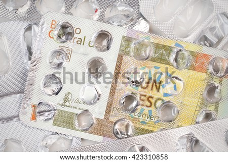 Banknote 1 Cuban peso on an empty blister pack of tablets - stock photo