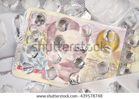 Banknote 200 Georgian lari on an empty blister pack of tablets - stock photo