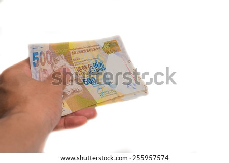 Banknote hkd in hand pay for goods and service, Hong Kong $500 banknote - stock photo