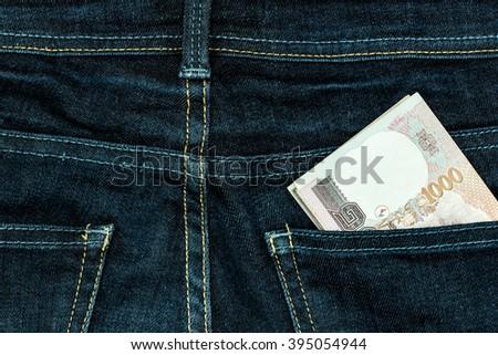banknote,money,cash in the pocket pants or trouser of dark blue jean denim / cash back / cash loan / financial background - stock photo