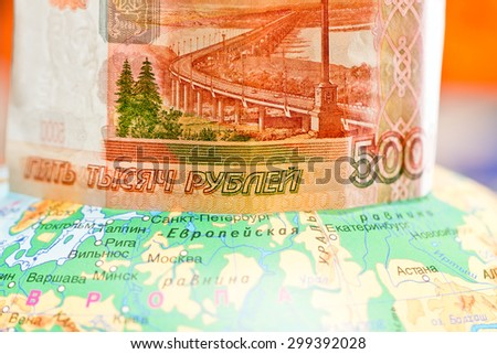 Banknote of five thousand rubles on the globe - stock photo
