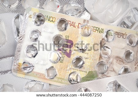 Banknote 20 Peruvian Nuevo Sol on an empty blister pack of tablets - stock photo