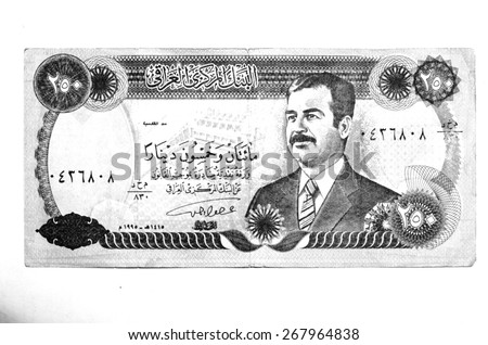 Banknote with the portrait of Saddam Hussein (black and white)