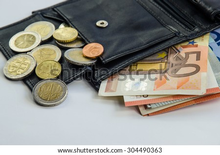 banknotes and coins in black wallet