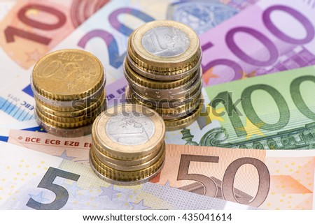 banknotes and coins of Euro currency - stock photo