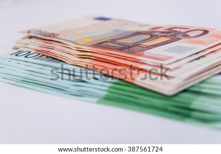banknotes 50 and 100 euro closeup as background - stock photo
