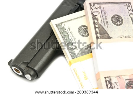 banknotes and gun on white background closeup - stock photo