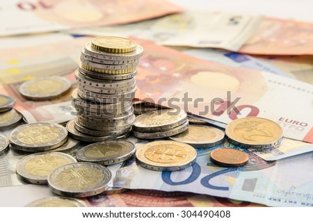 banknotes and pile of coins