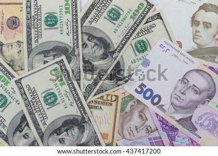 banknotes, clear image of dollars and new bills Ukrainian national currency hryvnia. namely hundred and five hundred hryvnia - stock photo