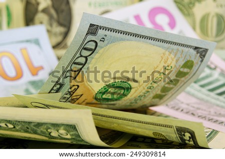 Banknotes dollars in disorder lie in the plane.