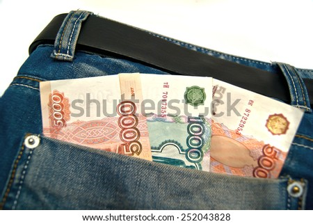 Banknotes in a blue jeans pocket on white - stock photo